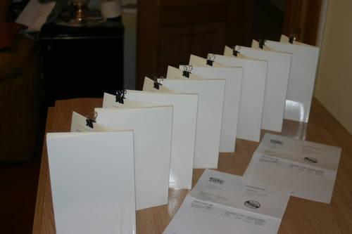 Ocho libros de Lulú con portadas en blanco.